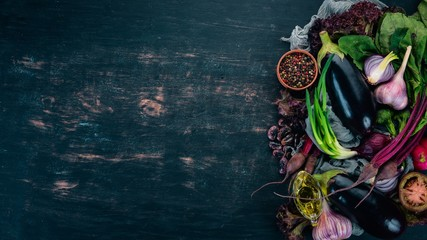 Purple food. Fresh vegetables and berries. On a wooden background. Top view. Copy space.