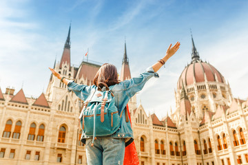 Aluminium Prints Budapest Happy asian casual woman student enjoying great view of the Parliament building in Budapest city, travel in Europe concept
