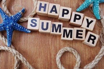 happy summer with nautical decoration on wooden background holiday's concept