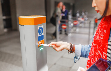 Validate a ticket at a validation machine for access to the underground city transport system