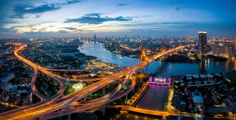 Aerial view of Bhumibol suspension bridge cross over Chao Phraya River in Bangkok city with car on the bridge at sunset sky and clouds in Bangkok Thailand. Wall mural