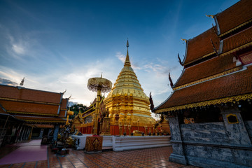 Golden pagoda in Wat Phra That Doi Suthep Temple at sunrise on the top of Doi Suthep mountain in Chiang Mai, Thailand.