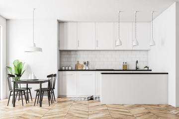 White kitchen interior, black table