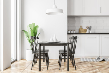 White kitchen interior, black table, side view