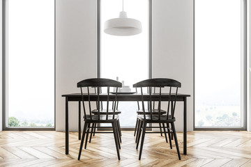 White dining room interior, black table