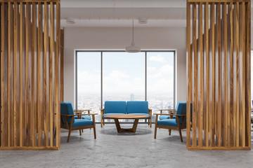 Wood office waiting room interior, blue sofas