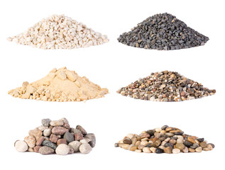 Piles of various gravel, stones and pebbels isolated on white background