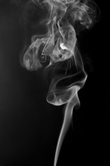 Texture of smoke clubs on a dark background.
