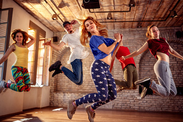 Dancer team - dancer friends jumping during music