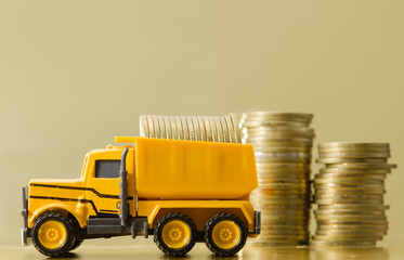 toy truck carrying with full of coins