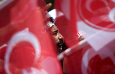 A supporter of Devlet Bahceli, leader of Nationalist Movement Party (MHP), attends an election rally in Ankara
