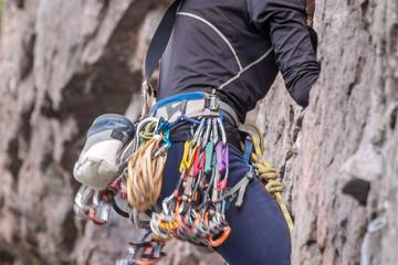 Rock climbing. Climber close-up. Extreme sport. A young climber climbs a vertical granite rock.