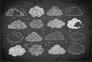Set of doodle sketch clouds on blackboard background