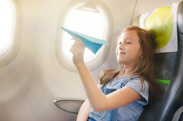 The girl sits in salon the plane