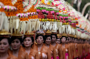 Balinese women take part in a parade during the annual Bali Arts Festival in Denpasar, Bali