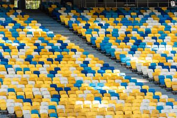 Foto auf Leinwand Stadion empty colorful stadium tribunes with stairs