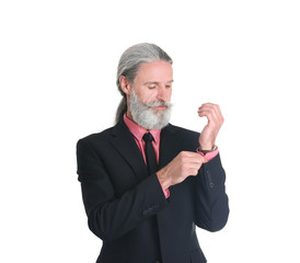 Handsome bearded mature man in suit on white background