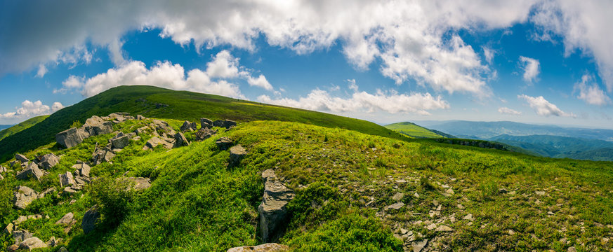panorama of Runa mountain with two peaks. valley of rocks behind the grassy hump. wonderful cloudscape on a blue sky. breathtaking view of mountainous summer landscape in Carpathians