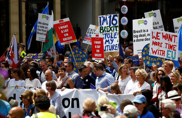 EU supporters, calling on the government to give Britons a vote on the final Brexit deal, participate in the 'People's Vote' march in central London