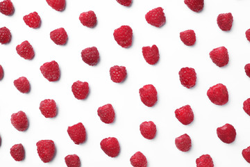 Delicious ripe raspberries on white background, top view