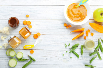 Flat lay composition with baby food and ingredients on wooden background Wall mural