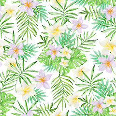Pattern with tropical flowers and green palm leaves