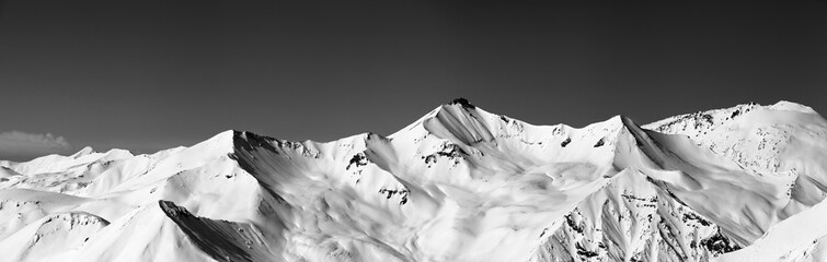 Wall Mural - lack and white panoramic view on snowy off-piste slopes