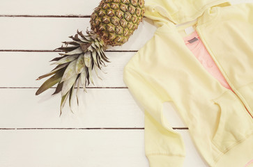 Yellow Hoodie And  Shirt, Pineapple. White Old Wooden Background