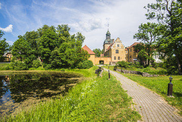 A panoramic view of the Lielstraupe Castle on a sunny summer day, Latvia