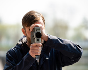 cameraman shoots a movie camera on a trip.