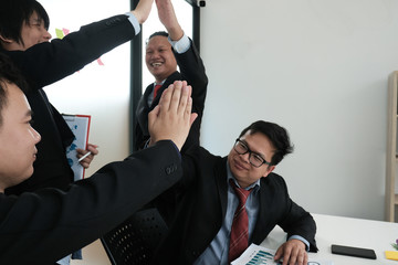 business co-worker team raise hands with happiness for successful project. cheerful businessman showing gladness for achievement