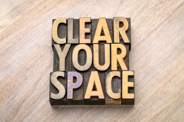 clear your space - word abstract in wood type