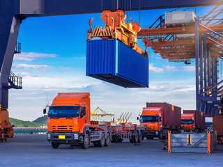 Industrial port crane lift up loading export containers box onboard from truck at port of Thailand,The port crane type's twinlift is the best solution for port operations. Wall mural
