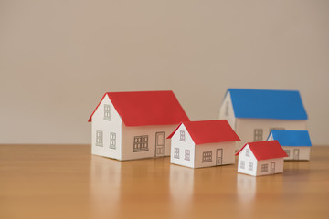 paper houses stands over a wooden background