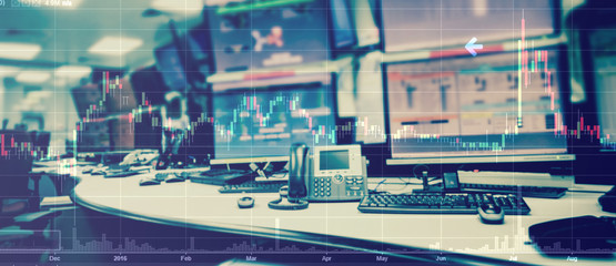 Double exposure of business stock trading room with computer and graph for Business Trading concept