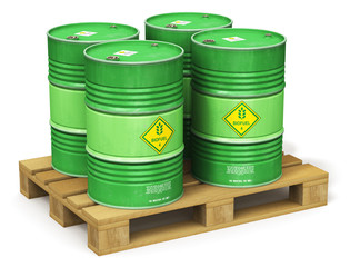 Group of green biofuel drums on shipping pallet isolated on white
