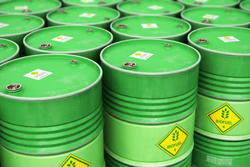 Group of rows of green stacked biofuel drums in storage warehouse