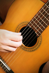 Photo sur Aluminium Musique Acoustic guitar strings. Classical guitarist hands