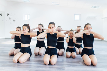 The group of beautiful teenage girls practicing modern ballet dance.