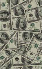 One hundred dollar bills abstract background