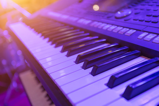 Piano keyboard instrument closeup. Home synthesizer