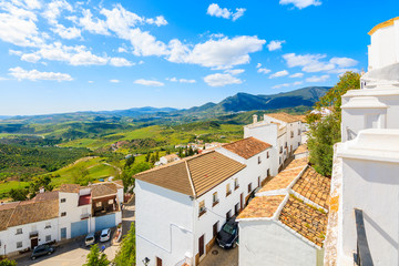 Fototapete - White houses in Zahara de la Sierra village in spring season on sunny beautiful day, Andalusia, Spain
