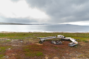 Poster Arctic A place to relax with benches and a campfire on the shore of the northern Barents Sea