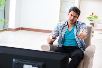 Man watching tv at home