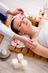 Young woman during spa procedure in salon
