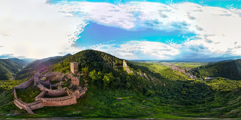 360-degree panoramic aerial view from drone to Vosges mountains and ruins of medieval castles Saint-Ulrich and Girsberg, Ribeauville, Alsace, sunset time.