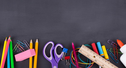 School Supplies on a Blackboard Background