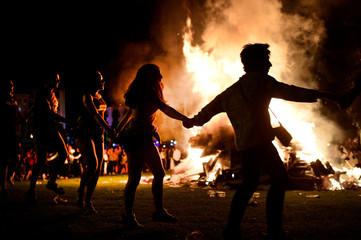 People dance around a bonfire on San Juan's Night in Mundaka,
