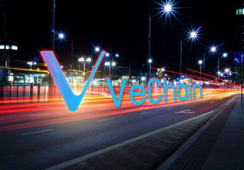 Concept of Vechain coin moving fast  on the road, a Cryptocurrency blockchain platform , Digital money