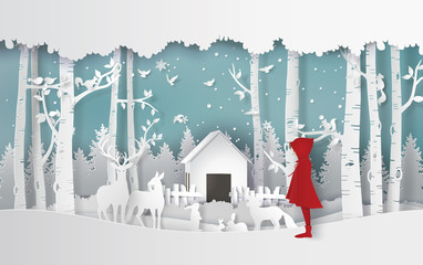 winter season with the girl in red coat and the animal in the jungle.